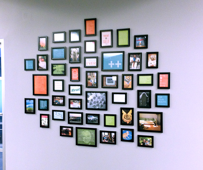 Photo of photo collage wall in Palantir office