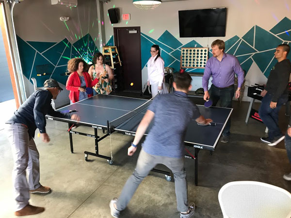 photo of team playing ping pong