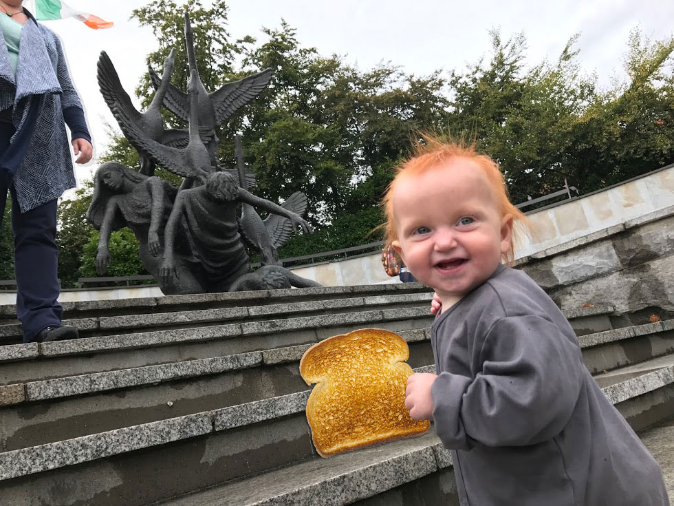 Photo of Avi's daughter holding a piece of toast