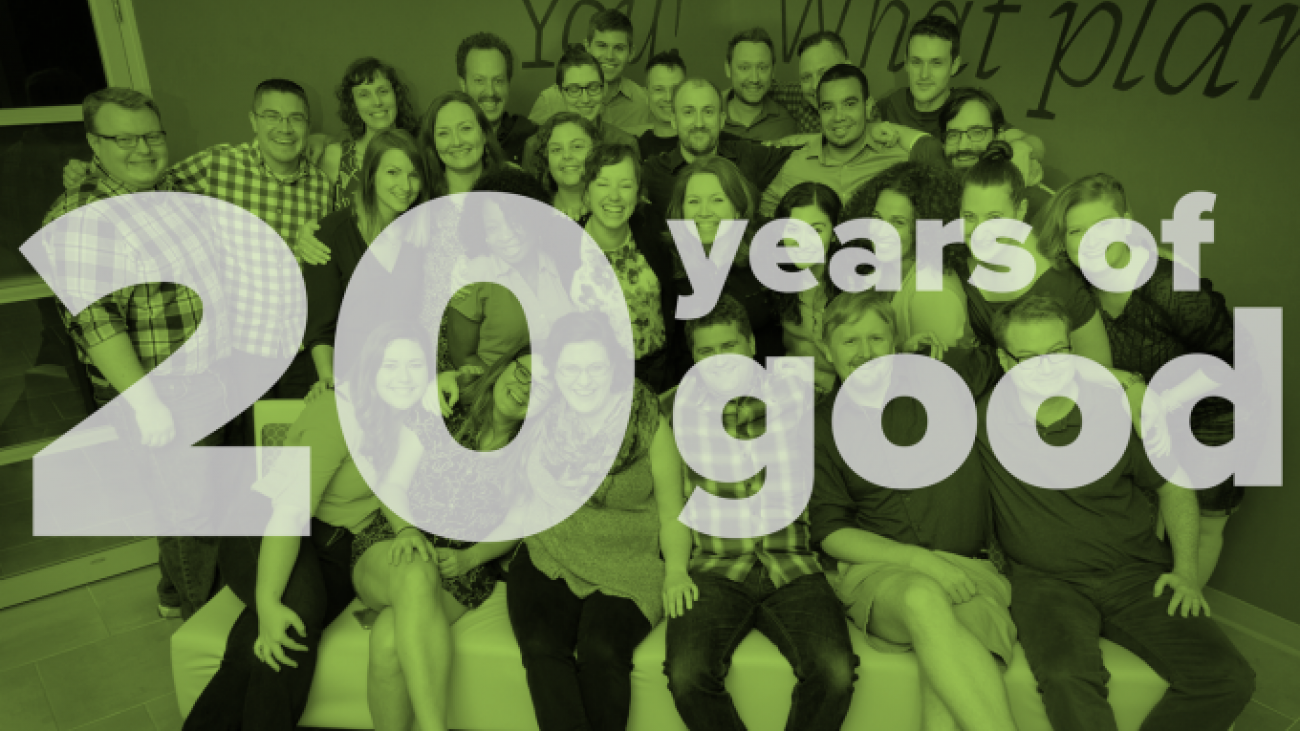 "Group photo of all Palantir team members with the text ""20 years of good"""