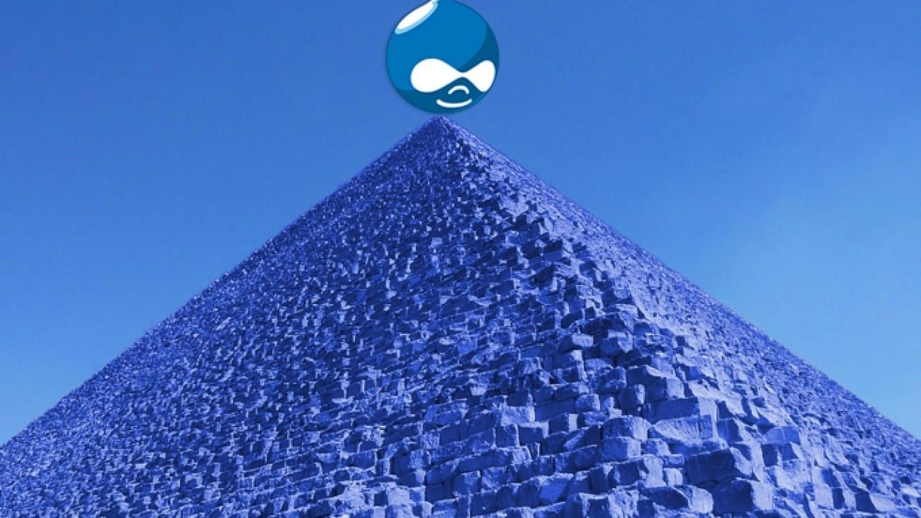 Blue photo of pyramid with Drupal logo sitting on top