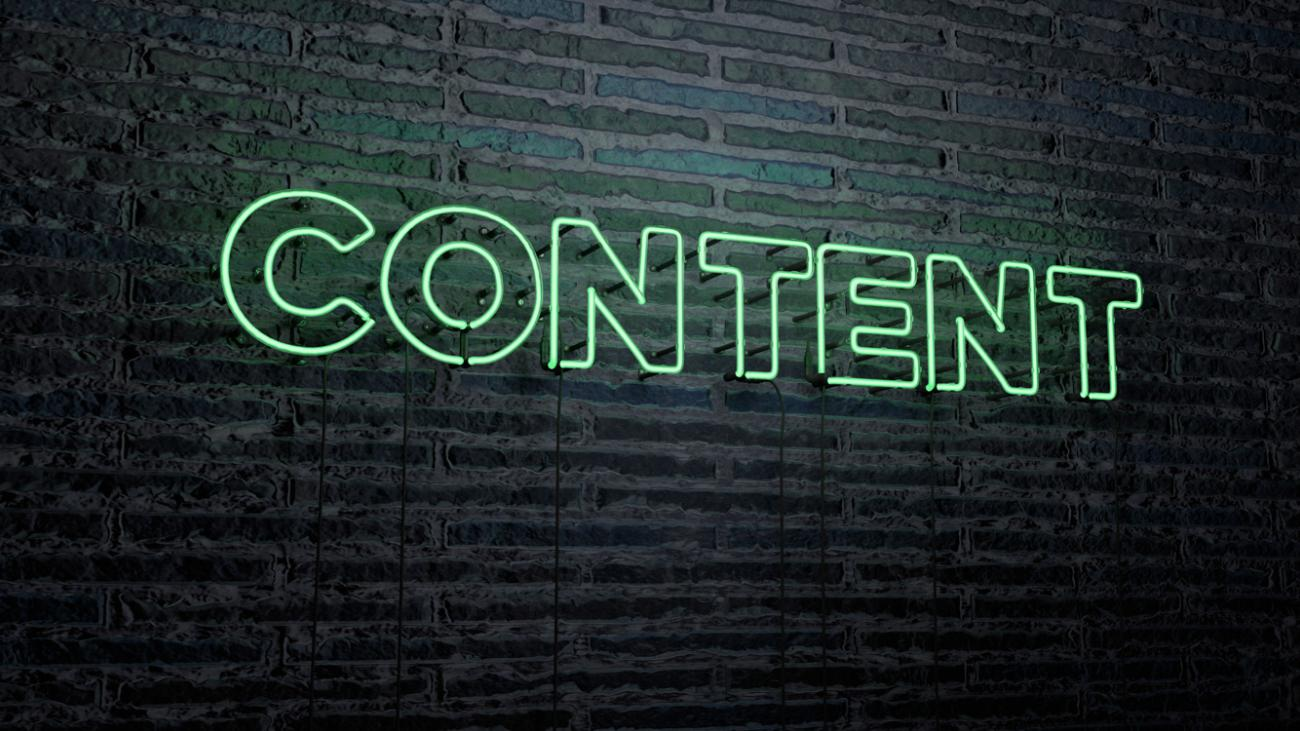 "Neon sign on brick wall that reads ""content"""